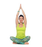 Young woman practicing yoga, sitting in a lotus position, isolat Royalty Free Stock Photos