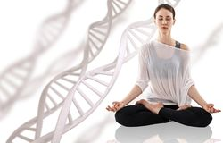 Young woman practicing yoga near big molecule chain. Young woman practicing yoga, sitting in a lotus position near big molecule chain. Over beige background Stock Images