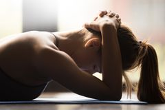 Young woman doing neck muscle group exercise stock image