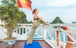 Young woman practicing yoga Stock Photos