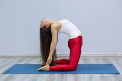 Young woman practicing yoga in a urban background royalty free stock photography