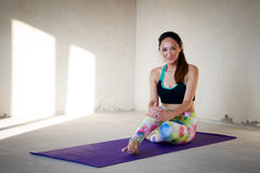 Young woman practicing yoga in a urban background Royalty Free Stock Image
