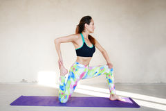 Young woman practicing yoga in a urban background Royalty Free Stock Photo