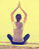 Young woman practise yoga cross-legged Royalty Free Stock Photography