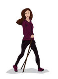 Young woman practising nordic walking Royalty Free Stock Photo