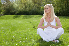 Young woman practising yoga Royalty Free Stock Image