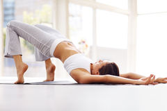 Young woman practising yoga exercise Stock Image