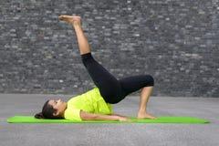 Young woman practising yoga Royalty Free Stock Photos