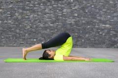 Young woman practising yoga Stock Photos