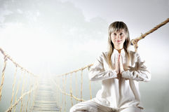 Young woman in the prayer lotus position. Stock Photo
