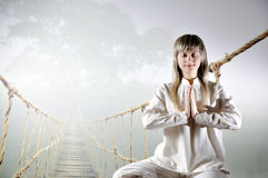 Young woman in the prayer lotus position. Royalty Free Stock Photos