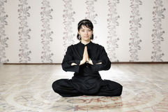 Young woman in the prayer lotus position. Stock Images