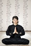 Young woman in the prayer lotus position. Royalty Free Stock Image