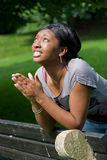 Young Woman Praying. A young woman praying with her hands together Royalty Free Stock Photos