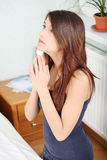 Young woman praying. At home Royalty Free Stock Photo