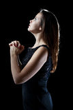 Young woman praying. Royalty Free Stock Photography