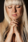 Young woman praying Stock Photos