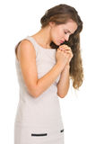 Young woman praying. Isolated on white Stock Photo