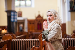 Young woman praying in church Stock Image