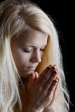 Young woman praying Stock Photography