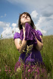 Young woman praying in a field Stock Images