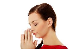 Young woman praying with her hands together Royalty Free Stock Photos