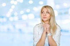 Young woman praying Royalty Free Stock Photos