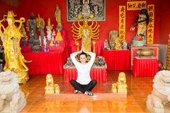 Young  woman praying and meditating buddha temple, Thailand, Phuket Stock Photography