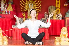 Young  woman praying and meditating buddha, Thailand, Phuket Stock Photo