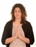 Young woman praying Stock Images