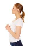 Young woman praying - religion concept Stock Photos