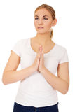 Young woman praying - religion concept.  Stock Photography