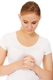 Young woman praying - religion concept.  Royalty Free Stock Photo