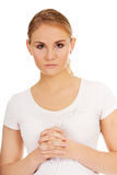 Young woman praying - religion concept.  Royalty Free Stock Photography
