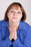 The young woman prays to god. Has prayerfully combined hands Royalty Free Stock Photo