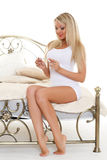 Young woman with pregnancy test. Royalty Free Stock Photos