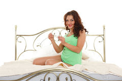 Young woman with pregnancy test. Royalty Free Stock Photo