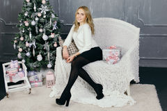 Young woman during preparations for Christmas at home Royalty Free Stock Photography