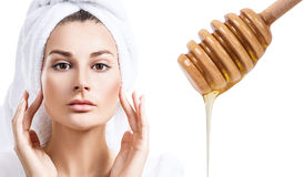 Young woman prepare for honey facial mask. Royalty Free Stock Photography
