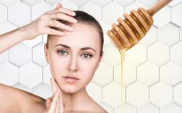 Young woman prepare for honey facial mask. Royalty Free Stock Images