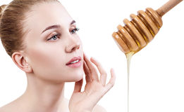 Young woman prepare for honey facial mask. Young woman and honey spoon prepare for facial mask. Honey treatment concept Royalty Free Stock Photo