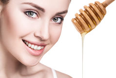 Young woman prepare for honey facial mask. Royalty Free Stock Image