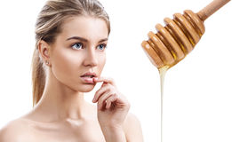 Young woman prepare for honey facial mask. Stock Images