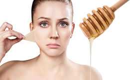 Young woman prepare for honey facial mask. Stock Photography