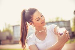Young woman prepare for run. Close up image. Beautiful young sports woman Stock Image