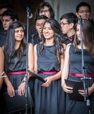 Young woman prepares for solo performance in choir Stock Image
