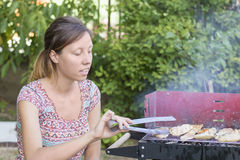 Young woman preparing barbecue Stock Image