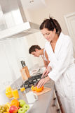Young woman preparing breakfast in the kitchen Royalty Free Stock Photography
