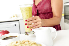 Young woman preparing breakfast or about to have breakfast Stock Photo
