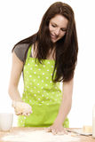 Young woman preparing dough Stock Images